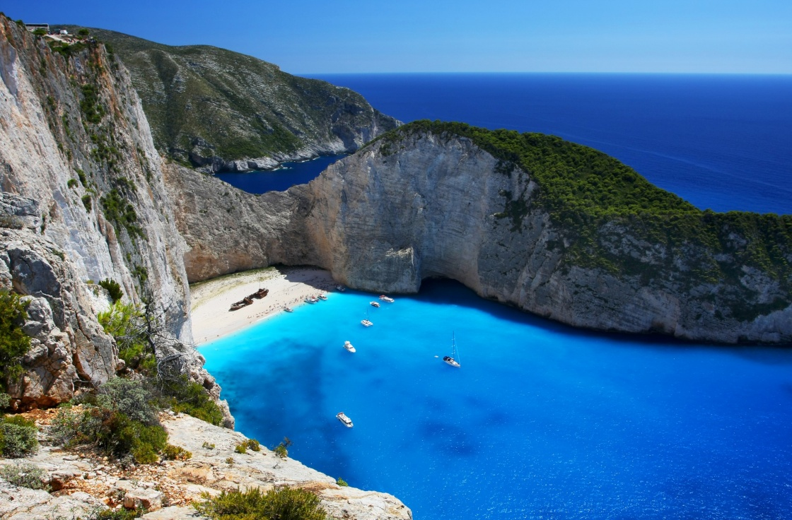 'Navagio - the most famous beach on Zakynthos island with shipwreck and anchoring boats  (Greece, Ionian islands)' - Zakynthos